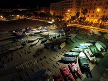 Boats park illuminated by moon. Boats parked on the beach in 'liguria' at night Stock Image