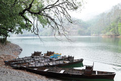 Boats parked on the bank of beautiful Sattal lake Stock Image