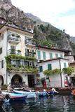 Boats parked in the Italian Lake Garda, under the mountains. In the historic city Limone Royalty Free Stock Photo