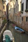 Boats parked at a narrow canal Stock Photo