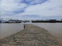 Boats parked near dock Royalty Free Stock Photos