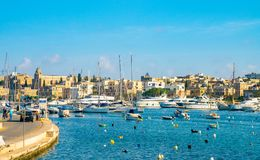 Boats parked in a Spinola bay near Valletta, Malta. Island near Valletta and Marsaxlokk village Royalty Free Stock Photography