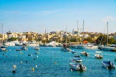 Boats parked in a Spinola bay near Valletta, Malta. Island near Valletta and Marsaxlokk village Stock Photo