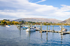 Boats parking at the jetty of Lake Wanaka ,south island of New Zealand. Stock Photography