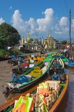 Boats parking outside of Phaung Daw U Pagoda in Inle Lake, Myanmar Stock Photos