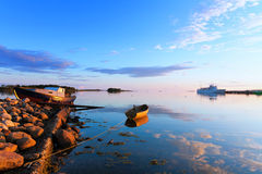 Boats and passenger ship off the coast of the Big Solovetsky Isl Stock Photo