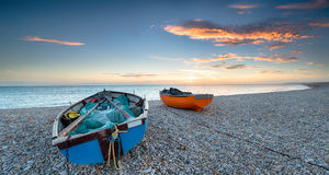 Boats on a Pebble Beach Royalty Free Stock Image