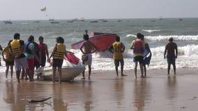 Boats and people on Arabian sea beautiful resort beach in Goa, Panaji. GOA, INDIA, JANUARY 11, 2014: boats and people on Arabian sea beautiful resort beach in stock video