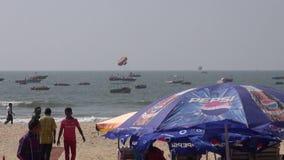 Boats and people on Arabian sea beautiful resort beach in Goa, Panaji. GOA, INDIA, JANUARY 11, 2014: boats and people on Arabian sea beautiful resort beach in stock video footage