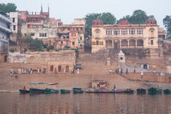 Boats and people at the Ghat. Holy river in Varanasi, Uttar Pradesh, India Stock Photo