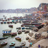 Boats and people on the ghats of Ganges river Stock Images