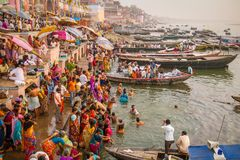 Boats and people on the ghats of Ganges river Royalty Free Stock Photo