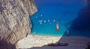 Boats and people at shipwreck beach Stock Image