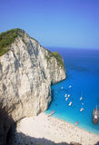 Boats and people at shipwreck beach Royalty Free Stock Photography