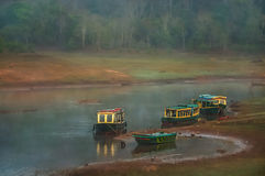 Boats in Periyar. Moored boat on the lake shore in the Periyar National Park, India stock images