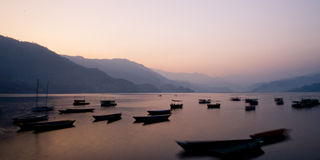 Boats on Phewa Lake. Boats on the Phewa lake, in Pokhara Royalty Free Stock Image