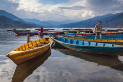 Boats on Phewa lake, Pokhara, Nepal Royalty Free Stock Image