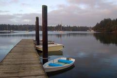 Boats at pier. Dingis tied up at pier Royalty Free Stock Photo