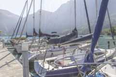 boats on the pier on the background of the mountains in the Austrian Alps royalty free stock photo
