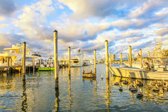 Boats at the pier of the bay at sunset. Stock Photos