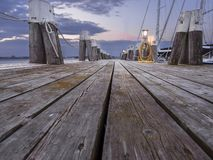 Boats at a pier. Beautiful sunset, with boats at a pier stock photography