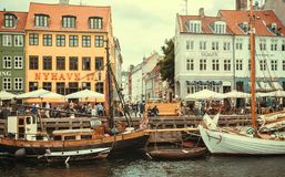 Boats at pier of Danish capital with historical buildings on popular Nyhavn area stock image