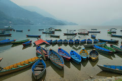Boats in the pier of Fewa lake in Pokhara Royalty Free Stock Photography