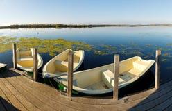 Boats at a Pier at a Lake Royalty Free Stock Photo