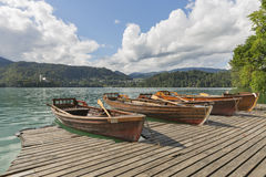 Boats at the pier of Lake Bled. royalty free stock images
