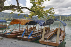 Boats at the pier of Lake Bled. stock images