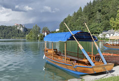 Boats at the pier of Lake Bled. royalty free stock photos
