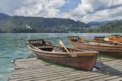 Boats at the pier of Lake Bled. Stock Image