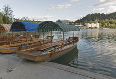 Boats at the pier of Lake Bled. royalty free stock image