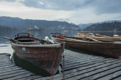 Boats on the pier. Lake Bled. Stock Photos