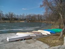 Boats on the pier. The landing stage of colorful boats in spring Stock Photography