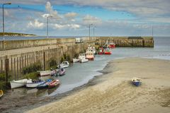 Boats at the pier at Magherroarty Co. Donegal.  stock images