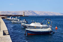 Boats by the pier of Senj. End of summer season Royalty Free Stock Photo