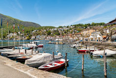 Boats at the pier on the shore of lake Maggiore in Ascona. Ascona, Ticino, Switzerland - May 4, 2016: Boats at the pier on the shore of lake Maggiore in Ascona Royalty Free Stock Images