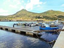 Boats at pier in the southern Italian port Favignana Stock Photos