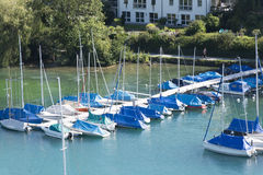 Boats at the pier of Spiez, Switzerland Stock Images