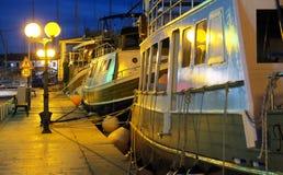 Boats on pier in Trogir, Croatia. Boats on illuminated pier in Trogir, Croatia at nighttime stock image