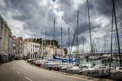 Boats in the Piran harbor under a threatening sky Royalty Free Stock Image