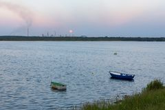 Boats on Pogoria 4 lake at moonrise. Dabrowa Gornicza, Poland Stock Image