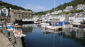 Boats in Polperro harbour summer day Stock Images