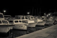 Boats in a port, late night stock photos