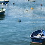 Boats in port of Malta. Colored buoys floating in port of Malta for mooring of yachts and boats Stock Photo