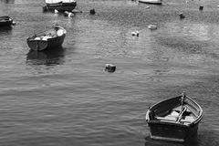 Boats in port of Malta. Colored buoys floating in port of Malta for mooring of yachts and boats. Black and white picture Royalty Free Stock Photography