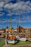 Boats in port with old houses in background in Gdansk, Poland Stock Images