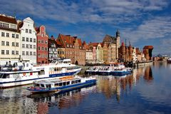 Boats in port and old houses in historical centre of Gdansk, Poland Stock Photography