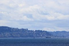 Boats in Puget Sound. Boats in the Puget Sound with Vashon Island in the background Royalty Free Stock Image